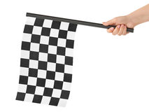 Checkered final flag. Checkered flag in hand isolated on white background stock photo