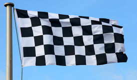 Checkered Flag. Nlowing in the wind royalty free stock photos