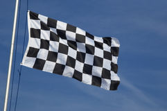 Checkered flag. End of race checkered flag waving in the breeze Royalty Free Stock Photo