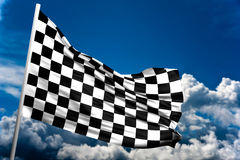 Checkered flag. Close up of a checkered flag in a blue sky Stock Photo