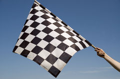 Checkered flag. Auto racing checkered flag on a background of the  blue sky Stock Images