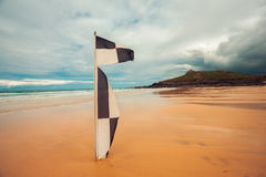 Checkered flag on the beach Stock Image