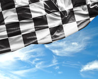 Checkered flag on a beautiful day background Royalty Free Stock Image