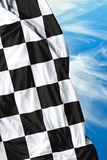 Checkered flag on a beautiful day background Royalty Free Stock Photos