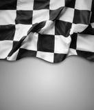 Checkered flag. Checkered black and white flag. Copy space Stock Photos