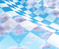 Checkered Flag with blue sky. Sky with checkered Flag with white and black squares representing the concept of winning and first place at the end of the Royalty Free Stock Images