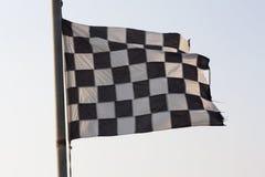 Checkered Flag and blue sky photo. Royalty Free Stock Photos