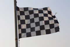 Checkered Flag and blue sky photo Stock Images
