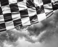 Checkered flag on a day bad background Stock Photos