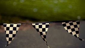 Checkered flag, F1 grounds Royalty Free Stock Photos