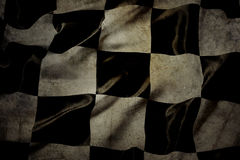 Checkered flag. Grungy checkered black and white racing flag Stock Images