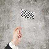 Checkered flag in hand. Isolated on white background Stock Photos