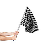 Checkered flag in hand. Isolated on white background royalty free stock photography