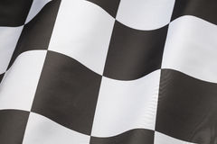 Checkered Flag. Single Checkered Flag with Wave in it Isolated on White Background Royalty Free Stock Photography