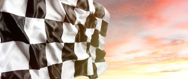 Checkered flag in sky. Checkered flag and bright sky royalty free stock photos