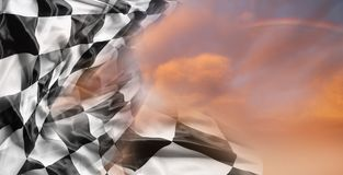 Checkered flag and sky stock images
