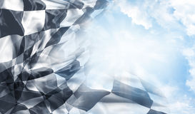 Checkered flag and sun. Checkered flag and blue sky royalty free stock image