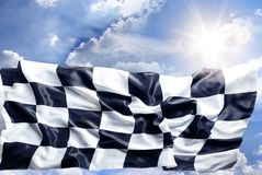Checkered flag. And sunny sky stock images