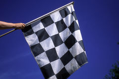 Checkered Flag For The Winner. The checker flag goes out is waived when the race is over when the winner crosses the finish line royalty free stock photos