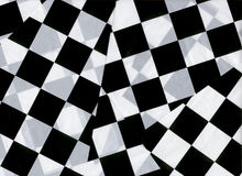 Checkered Flags. Overlapping checkered flags stock photography