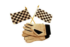 Checkered flags and gloves. Checkered flags that symbolize the finish line and driving gloves Stock Image