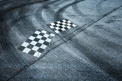 Checkered flags painted on asphalt floor Royalty Free Stock Image