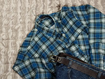 Checkered flannel shirt and jeans Stock Image