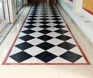 Checkered Floor. Black and White Checkered Floor Tiles in Corridor Royalty Free Stock Photo