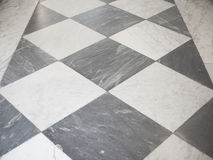Checkered floor. Black and white marble checkered floor background texture Stock Image