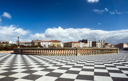 Checkered floor in city square Stock Photo