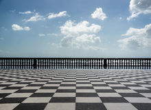 Checkered floor in city square Stock Photography