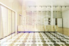 Checkered floor panoramic office toned. Modern office interior with a checkered floor, panoramic windows, and rows of computer tables. 3d rendering mock up toned Royalty Free Stock Images