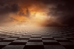 Checkered ground. With sunset sky and cloud on the sky stock photo