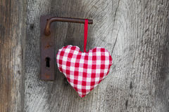 Checkered heart shape hanging on door handle for valentine, chri Royalty Free Stock Photos