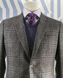 Checkered Jacket, Blue Sweater (vertical). Close up of a grey checkered jacket with blue v-neck sweater and purple tie Royalty Free Stock Photography