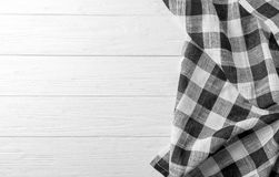 Checkered kitchen towel. On white wooden table Royalty Free Stock Photography