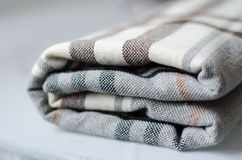 Checkered knitted folded blanket Stock Photo