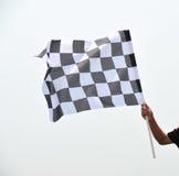Checkered laufende Markierungsfahne Stockfoto