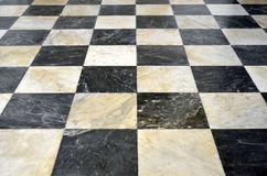 Checkered marble floor. In black and white stock photo