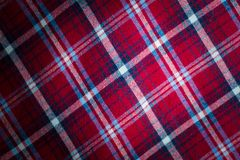 Checkered material background Stock Images
