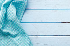 Checkered napkin on blue table Royalty Free Stock Photography