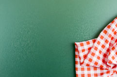 Checkered napkin on green board background Royalty Free Stock Photos