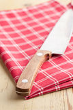 Checkered napkin and knife Stock Photo