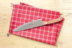 Checkered napkin and knife Stock Image