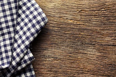 Checkered napkin on old wooden table Stock Photo