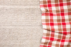 Checkered napkin from right side of tablecloth Royalty Free Stock Image