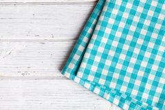 Checkered napkin. On wooden table Stock Images