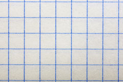 Checkered paper, a background. Stock Images