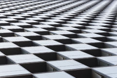 Checkered pattern on a modern building Royalty Free Stock Photo