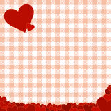 Checkered pattern with red hearts Stock Photos
